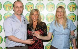 Steve and Rose receiving the award from Samantha Fox in London